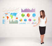 Business woman with colorful graphs and charts — Стоковое фото