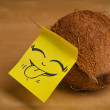 Post-it note with smiley face sticked on a coconut — Stock Photo