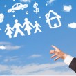 Hand pointing at family and household clouds — Stock Photo #38824493