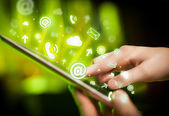 Hand touching tablet pc, social media concept — Stock Photo