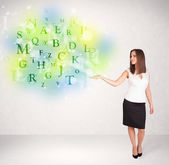 Business women with glowing letter concept — Stok fotoğraf