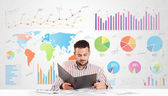 Business man with colorful charts — Stock Photo