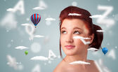 Beautiful young woman with wellness and healthcare clouds — Stock Photo