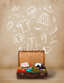 Traveler luggage with hand drawn clothes and icons — Stock Photo