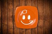 Visage cartoon smiley heureux sur plaque plat coloré — Photo