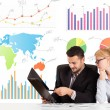 Business man and woman with colorful charts — Stock Photo #39744215