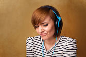 Young woman with headphones listening to music with copy space — Stock Photo