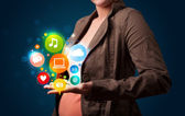 Young woman presenting colorful technology icons and symbols — Stock Photo