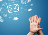 Happy smiley fingers looking at mail icons made out of clouds — Stock Photo