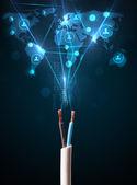 Icônes de réseaux sociaux qui sortent de câble électrique — Photo