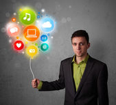 Businessman holding social media balloon — Stock Photo