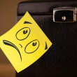 Foto Stock: Post-it note with smiley face sticked on jewelry box