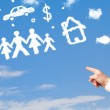 Hand pointing at family and household clouds — Stock Photo #40651539