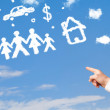 Hand pointing at family and household clouds — Stock Photo