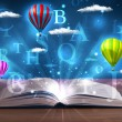 Foto Stock: Open book with glowing fantasy abstract clouds and balloons