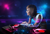 Disc jockey playing music with electro light effects and lights — Stock Photo
