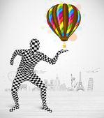 Man i hela kroppen kostym hålla ballongen — Stockfoto