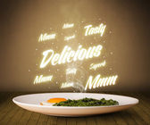 Food plate with delicious and tasty glowing writings — Stock Photo