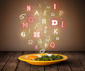 Fresh cook food with colorful letters on wood  — Stock Photo