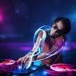 Disc jockey playing music with electro light effects and lights — Stock Photo #41594533