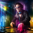 Dj playing songs in a disco with light show — Stock Photo #41594541