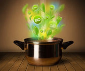 Bio signs coming out from cooking pot — Stock Photo