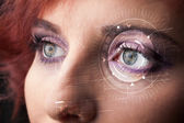 Cyber girl with technolgy eye looking — Stock Photo