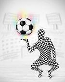 Man in full body suit holdig soccer ball — Stock Photo