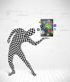 Man in full body suit holdig tablet pc — Stock Photo