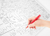 Human hand sketching ideas on a white paper — Stock Photo