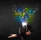 Business man with glowing media icons exploding head  — Stockfoto