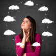 Stock Photo: Young woman thinking with cloud circulation around her head