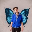 Foto Stock: Handsome young man with butterfly blue illustration on the back