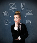 Young woman thinking with drawn gadgets around her head — Stock Photo