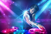 Energetic Dj mixing music with powerful light effects — Stock Photo