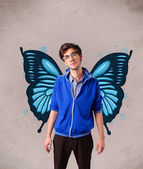 Handsome young man with butterfly blue illustration on the back — Stock Photo