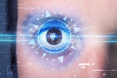 Cyber man with technolgy eye looking into blue iris — Stock Photo
