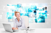 Business person at desk with modern tech images at background — Stok fotoğraf