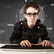 Stock Photo: Young hacker in futuristic enviroment hacking personal informati