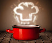 Chef hat above cooking pot — Stock Photo