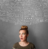 Young woman gesturing with sketched charts above her head — Stok fotoğraf