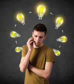 Young man thinking with lightbulb circulation around his head — Stock Photo