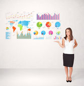 Business woman with colorful graphs and charts — Stock Photo
