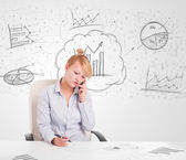 Business woman sitting at table with hand drawn graph charts — Stock Photo