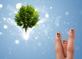Happy finger smileys with green magical glowing tree — Stockfoto
