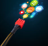 Social media icons coming out of electric cable — Stock Photo