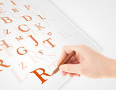 Hand writing various letters on white plain paper — Stockfoto