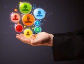 Social network icons in the hand of a businessman — Stock Photo