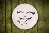 Feliz carinha de desenho animado no prato prato colorido — Foto Stock