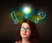 Young preety teenager with hand drawn light bulb illustration — Foto de Stock